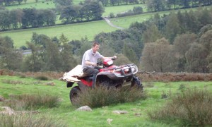 installation day- Sean driving the flat-pack sculpture up the valley on his quad bike